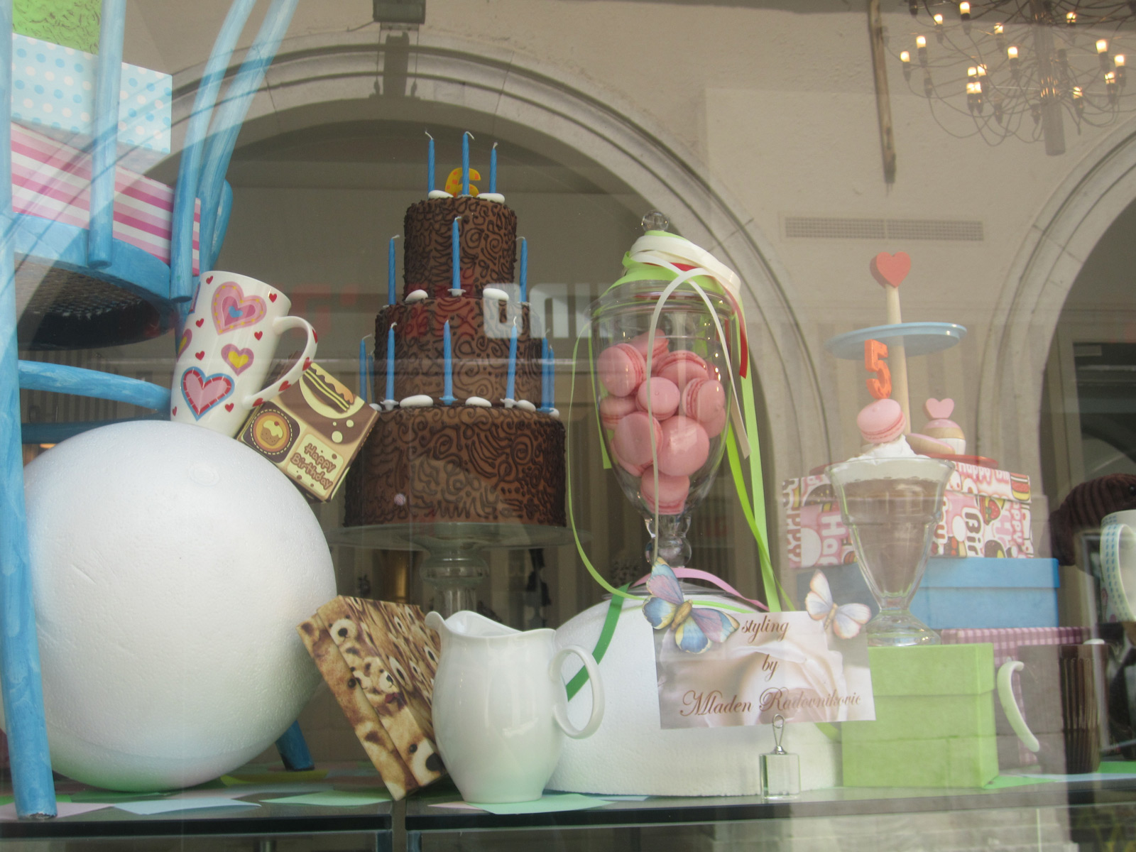 This could be a soft Easter window display, with this enchanting and feminine style, and a glass jar full of macarons.