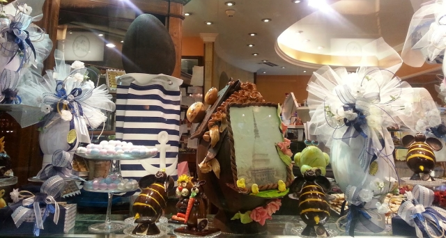A frame made of chocolate, that continue with a shape of an egg to be in theme with Easter. There are also other Easter ornaments in the window display.