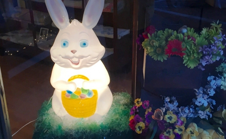 Something that wanted to be friendly turned on being creepy. Just look at this white bunny with a basket in his hands. This Easter window display has gone weird.