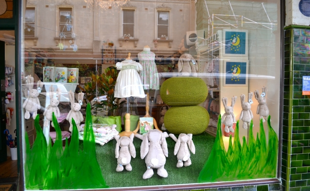 Fresh with green paint on the window display, and also cute dancing Easter bunnies made from plush.
