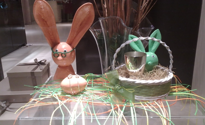 This window display is decorated for Easter with cute and funny rabbits, colored in green and pink.