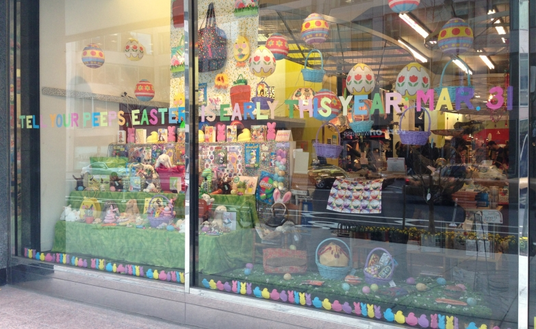 Hanging decorated Easter eggs and colored stickers on the bottom side of the window display.