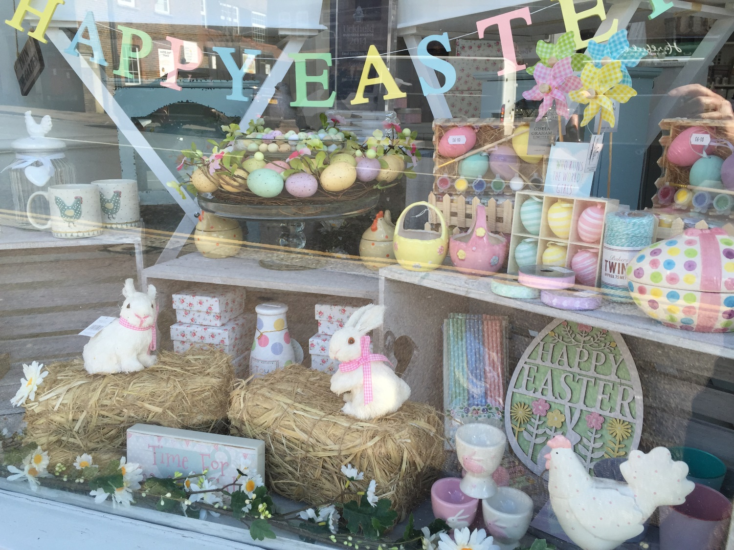 The happy Easter banner in colored letters, the eggs and the bunnies are a good decoration for the window display.