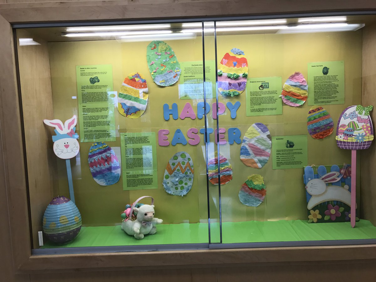 A simple and colored Easter window display, that could be made by kids, by the way that the eggs paintings are looking.