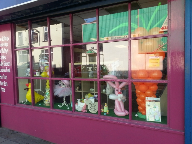 The decoration made for this Easter window display it's made from an oversized carrot, a balloon bunny and a feather filled bubble.
