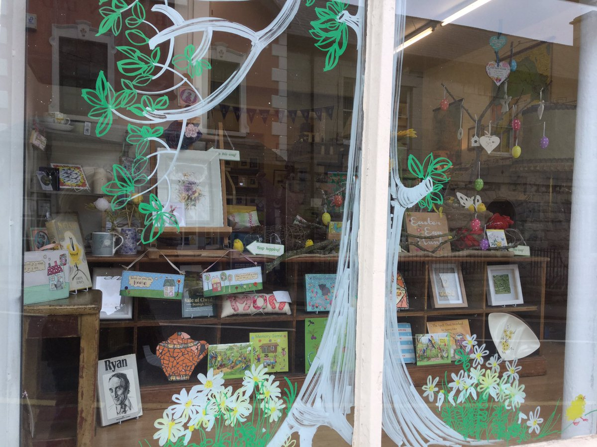 The painted window display, signify the living nature of beautiful flowers and the green leaves, that the spring and Easter time it is near.