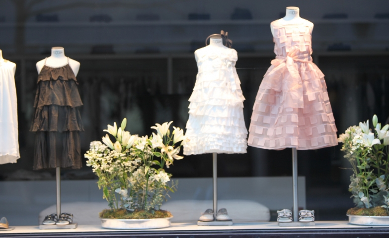 Some cute and simple Easter dresses, placed in the window display, available in pink, white and brown.