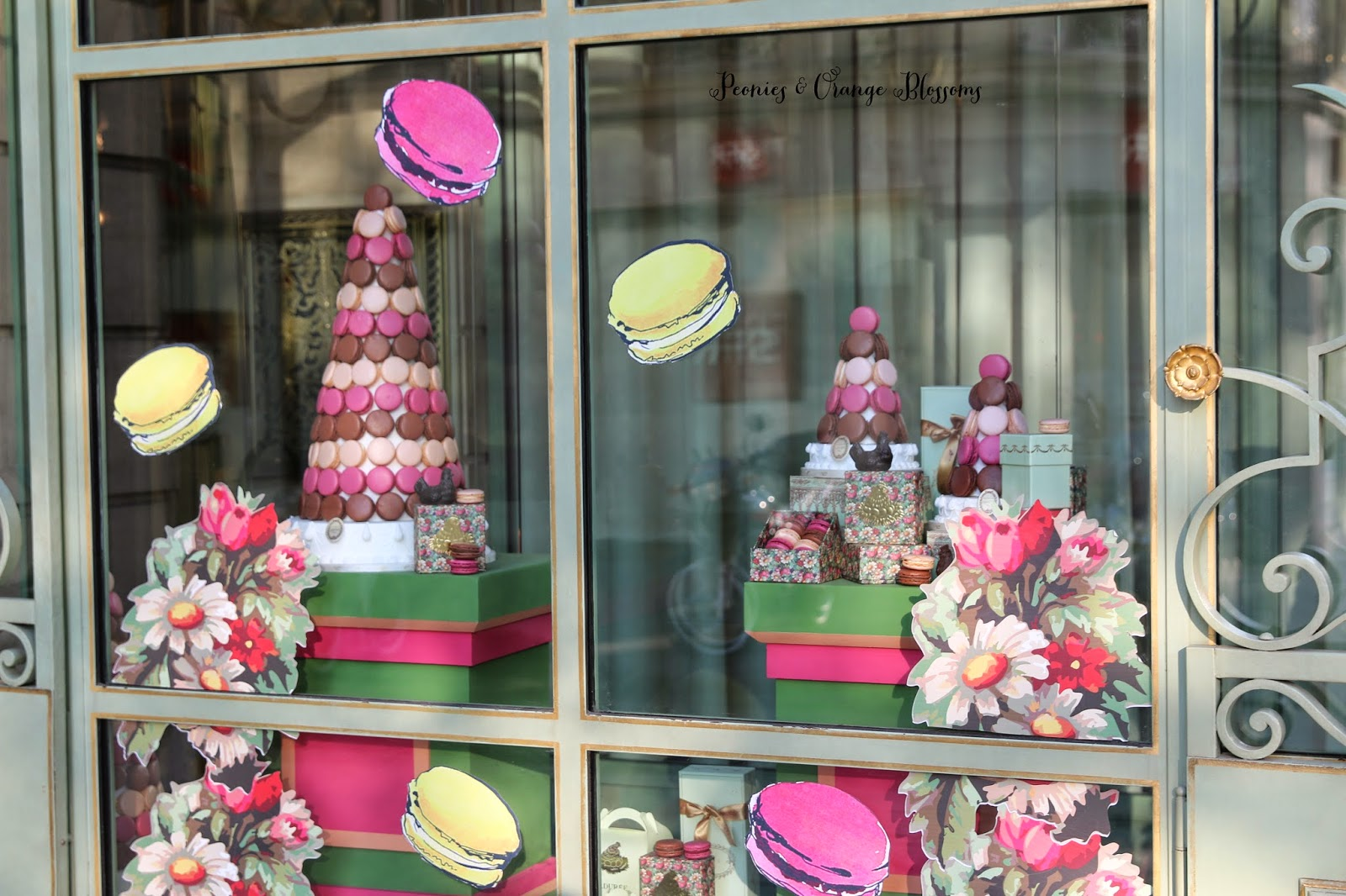 If you look closer, you can observe the chocolate chickens near the big towers of macarons. They were placed there to give a completed Easter form for the window display.