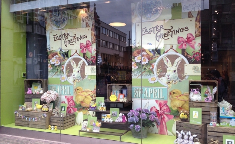 A happy colored window display, with two banners with bunnies and chicks, ready to capture any passerby's attention this Easter.