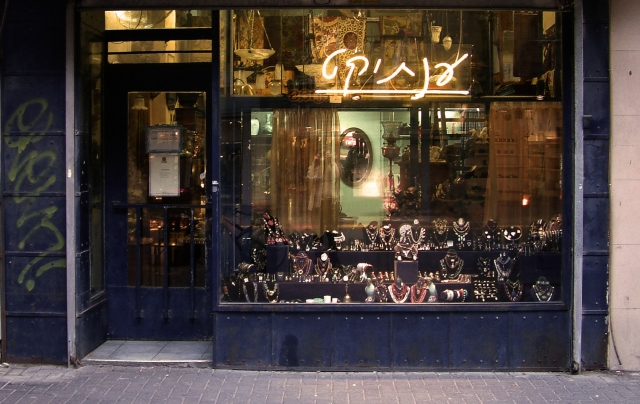 The Antiquette jewelry store window display: efficiently using neon signage and clustering a surprising amount of jewelry, while compensating for the rougher exterior facade.