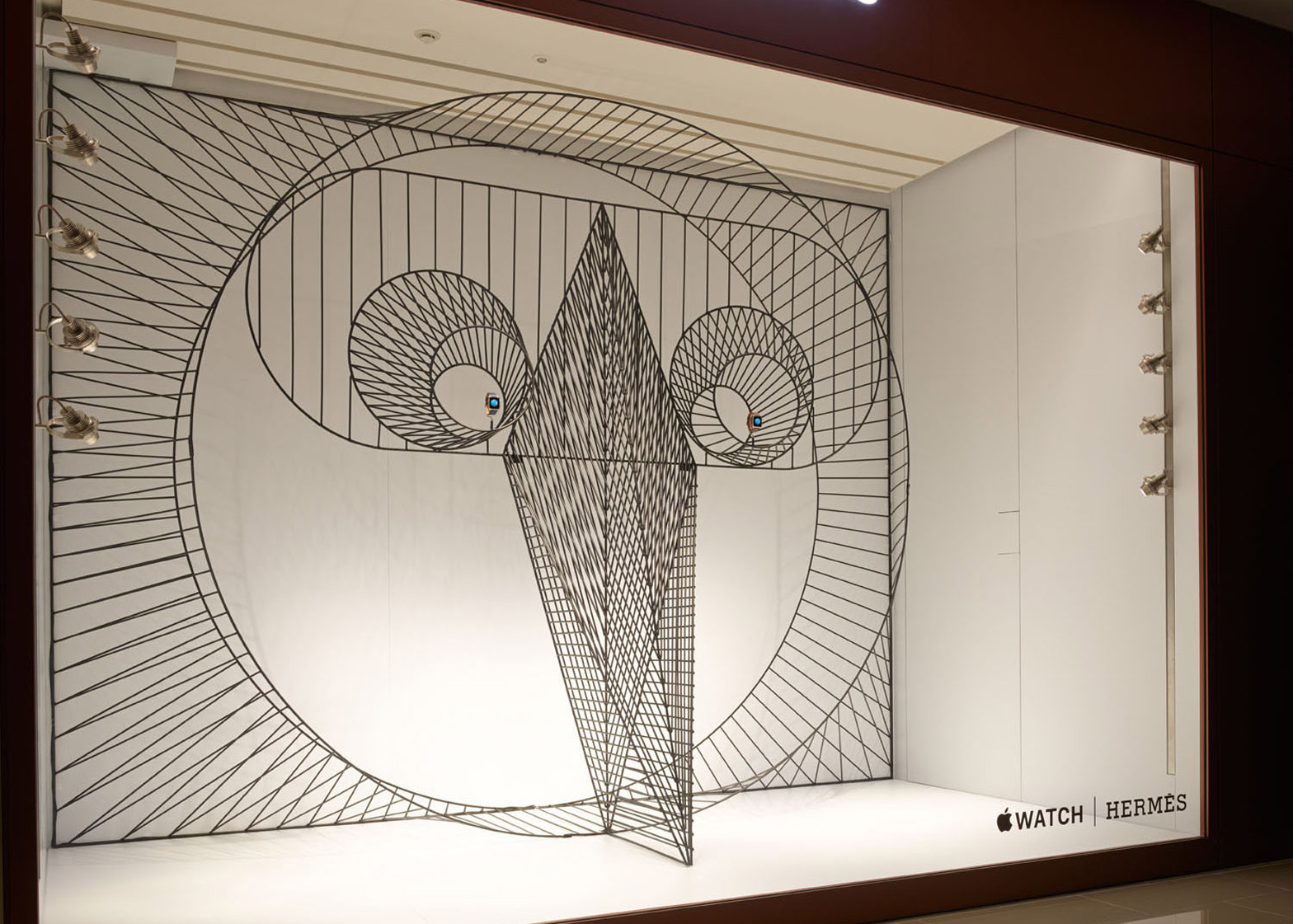 A Hermes window display focused on the Apple Watch, featuring geometric 3D minimalist motifs.