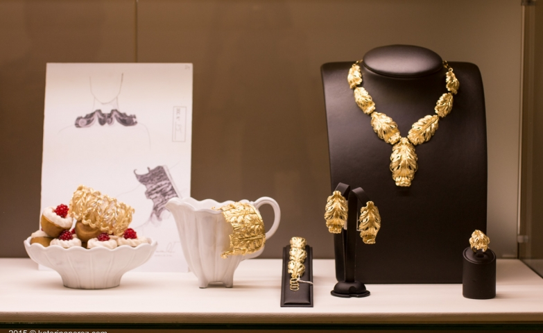 The Blount jewelry window display: clean, crisp and minimalist, featuring a cupcake bowl and gold jewelry, while alternating between black and white displays.