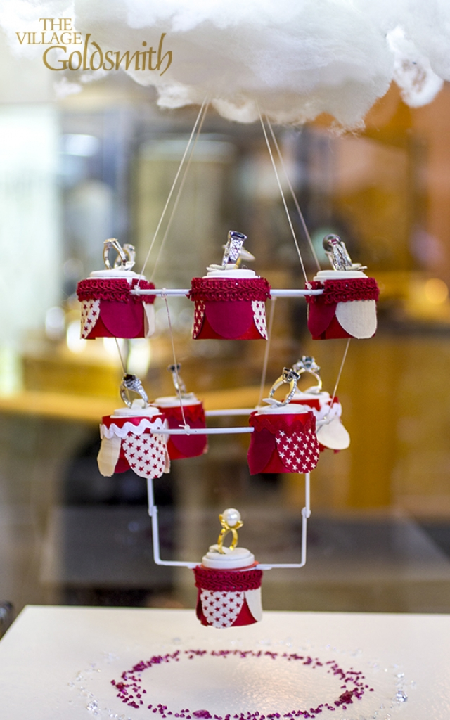 The Village Goldsmith's window display focuses on a little carousel theme, holding various previous stone rings, all held up by a little cloud.