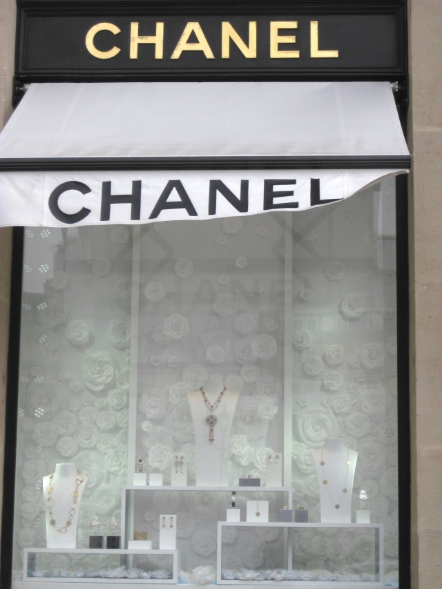 A zoomed out view of Chanel's window display. The white rose background attracts your attention immediately.