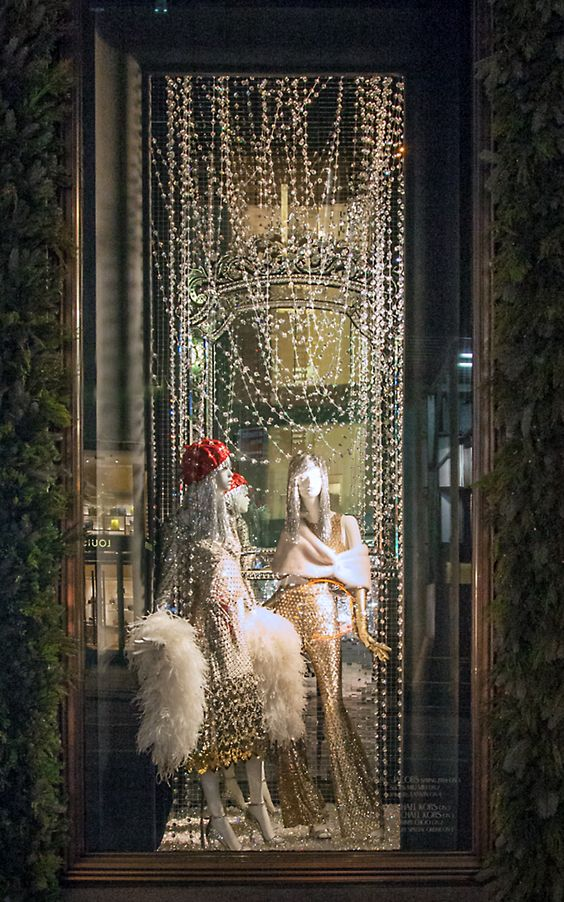 Creative window display with festive feeling as inspiration for Christmas windows from Bergdorf Goodman in New York.