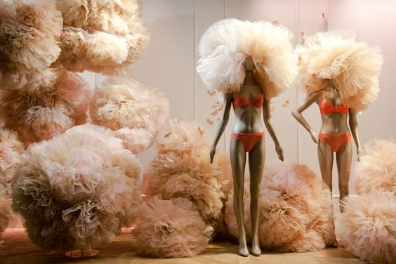 Fantasy window display in Paris, France with giant balls made with tutu.
