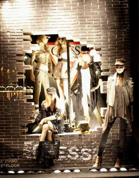 Great urban inspired visual merchandise window display for Guess, in Florence & Milan.