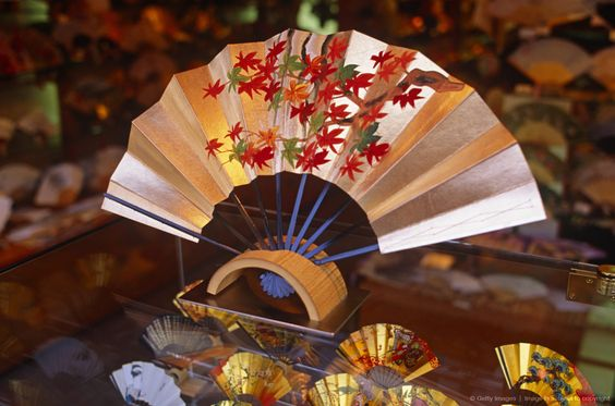 Beautiful window display of traditional Japanese fans will keep you window shopping.