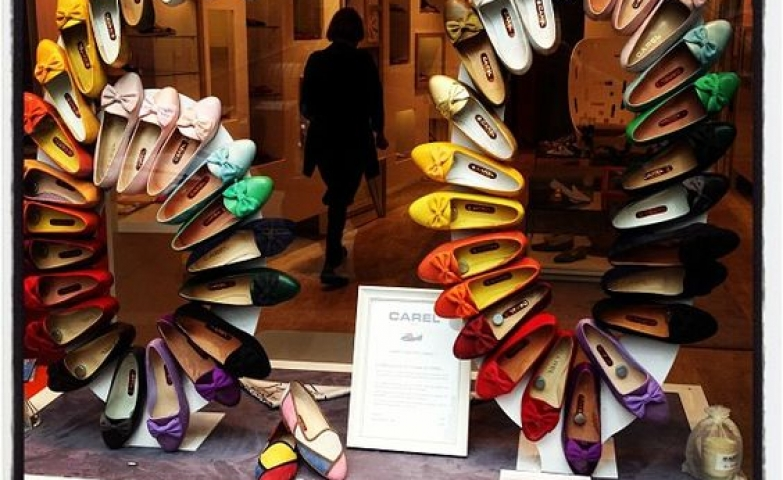 Shoe visual merchandising display on Rue du Four looks fabulous. Shoes arranged in the form of the number 60, in rainbow order.