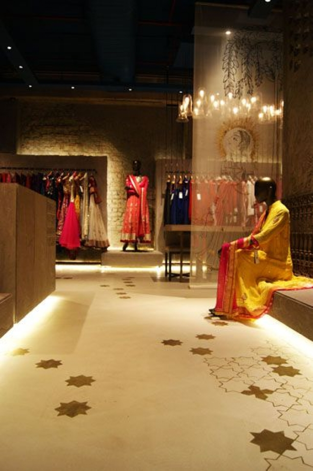 Inspiration from the Anju Modi store with beautiful flooring and a discretely seated black mannequin.