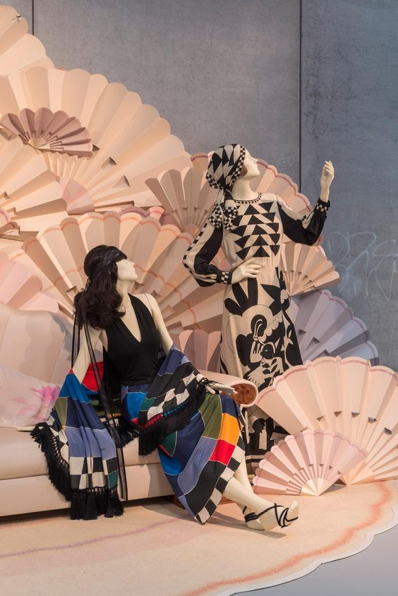 An Asian melancholy peeps in, as two female mannequins pursue an imaginary horizon, in their Twenties inspired attire.