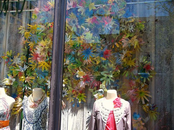Colorful storefront with a cascade of flowers, at Anthropologie City Center in Houston, Texas.