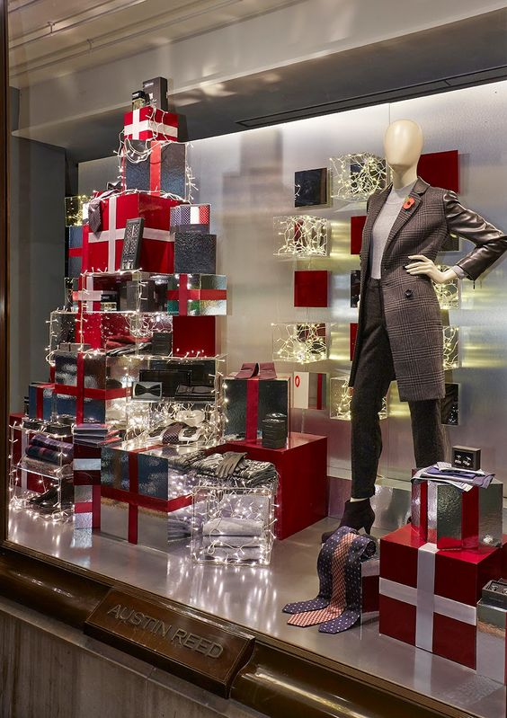 Austin Reed special holiday window display with three toned presents seen in London, UK.