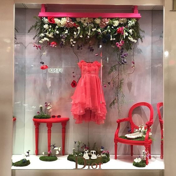 "Window store display for Baby Dior seen at the Galeries Lafayette in Paris, France. Theme display ""I look outside and what do I see?, I see Spring looking back at me!"""