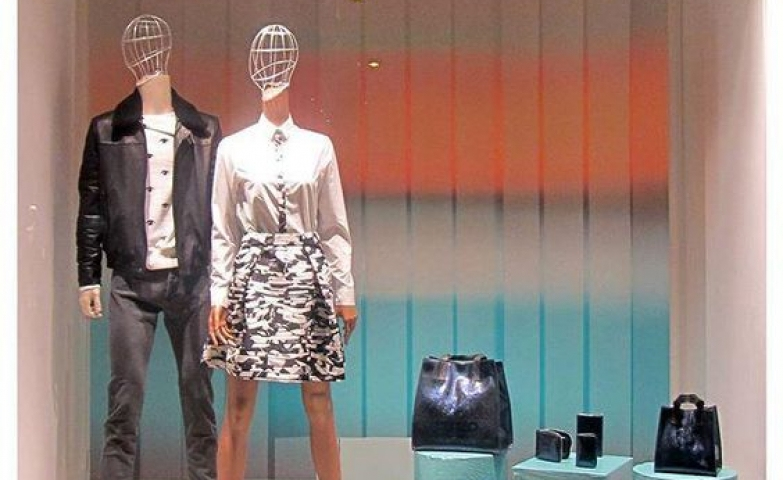 Retro background, turquoise boxes used to display accessories and unusual mannequins for the window of Kenzo in Milan, Italy.