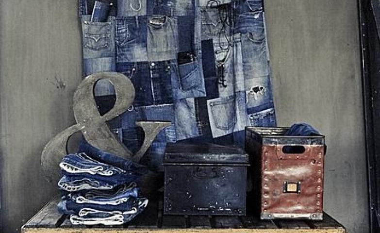Denim theme display made with vintage storage boxes, vintage stand and an accessories holder made entirely from jeans.