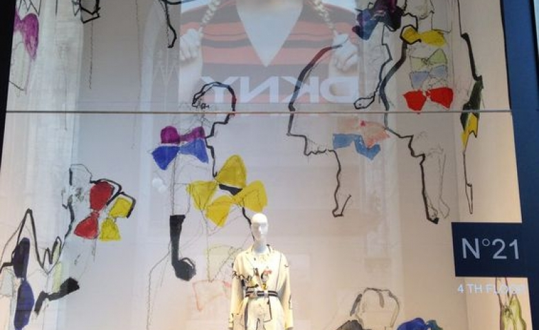 La Rinascente window display with fashion sketches during Fashion Week Spring 2015 collection in Milan.