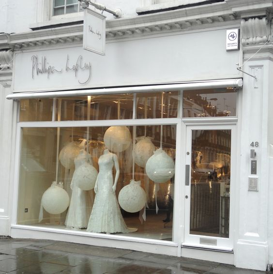 Bridal store visual merchandising display with suspended white balls in London.