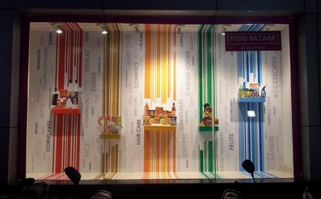 Though visual merchandising has never been appreciated in India, this display window idea using colored striped and words is very eye-catching.