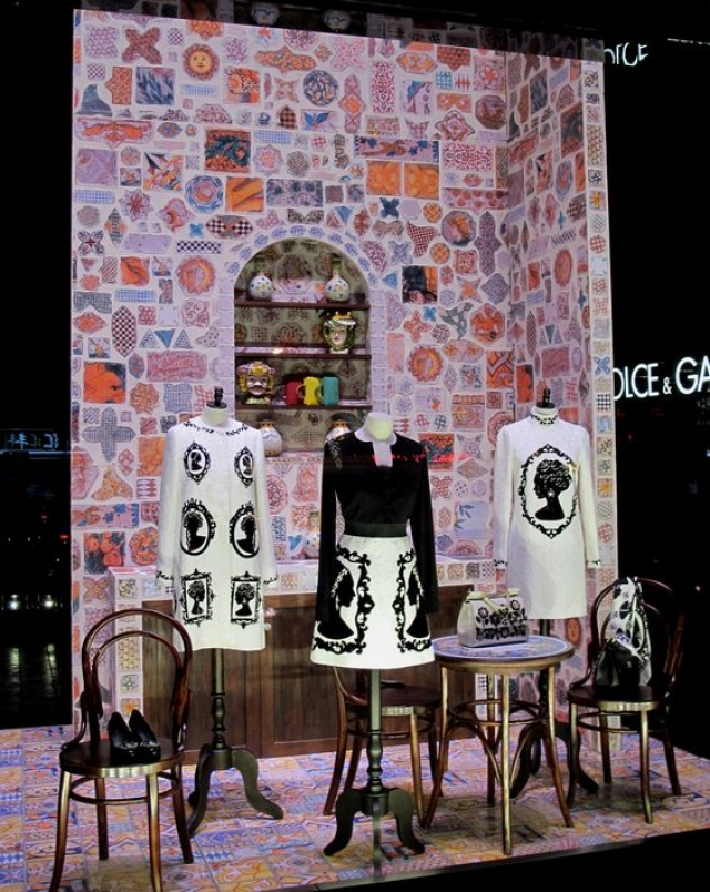Black & white merchandise and a colorful background creates and intense contrast, window display from Dolce & Gabbana in Shanghai, China.