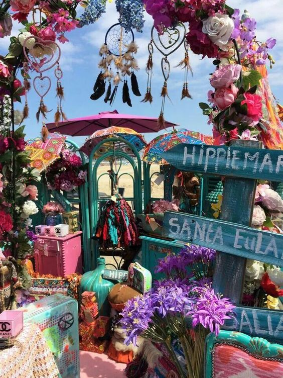 Colorful hippie market in Ibiza with lovely dream catchers, lots of flowers and custom signage.