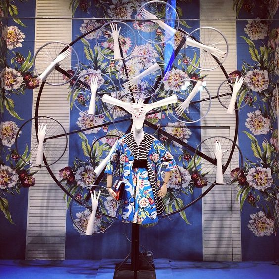 La Rinascente window display inspired by flowers and bicycles with unusual decoration during Milan Fashion Week.