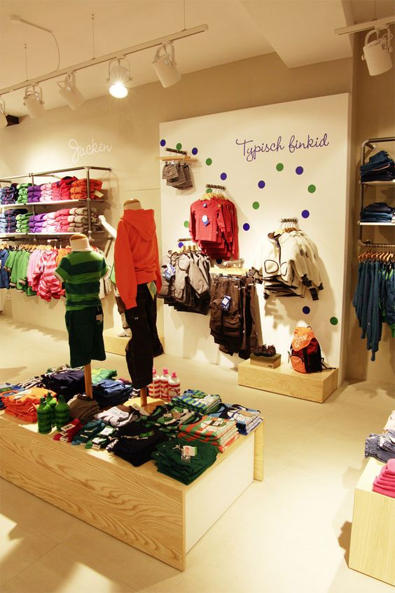 Fun, minimalist and colorful, this display in a kid's shop covers the large rage of products it has to offer in playful and organized manner.