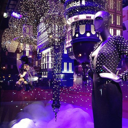 Window display made for the holiday season, Christmas time visual merchandising with many lights at Quartier de la Chaussee Dantin.
