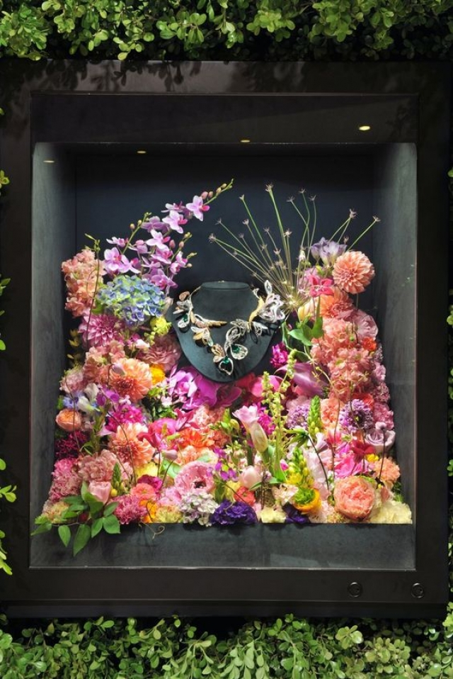 Great window display idea with lots of colorful flowers from Boucheron for jewels displays, seen in Tokyo.