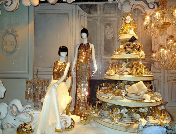 Working with lots of gold for this Christmas window display, visual merchandising for Dior, Printemps, Paris, France.