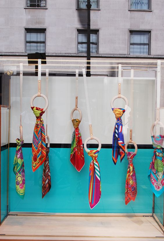 Bright and vivid colored scarfs hanging display, colors inspired in India by Hermes.