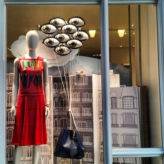 Speaking about eye catching, this display takes the saying literally, with a bunch of eye-shaped balloons carrying a modern bag, on a urban background and red dressed mannequin.
