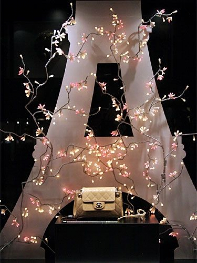 Chanel display in Tokyo, with a Eiffel Tower resembling figure in the back and flower lights.