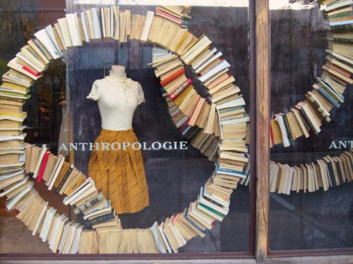 Visual merchandising display with circles made from book seen at Anthropologie in Barcelona.
