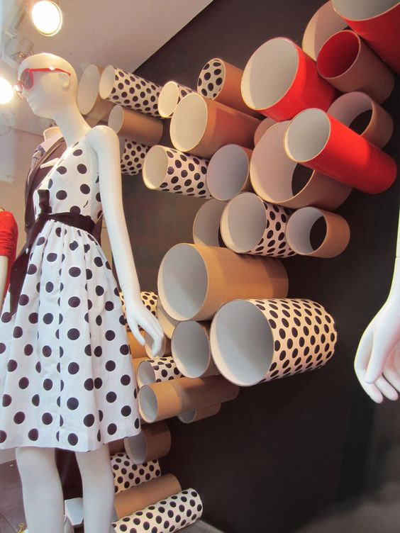 Visual merchandising created with the repetition of shapes and patterns on the cylinders, seen in NY.