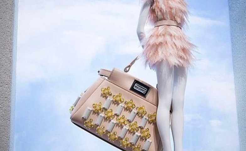 The sky is not the limit in this window display of Fendi Micro Collection. Beautiful pink merchandise seen in Paris, France.