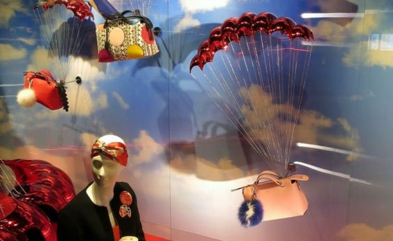 The Fendi display is absolutely dreamy , with a sky background and vivid red to make it pop, London.