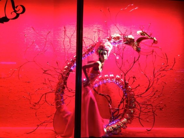 Harrods window display for the Chinese New Year with an intense red background and a snake looking prop figure.
