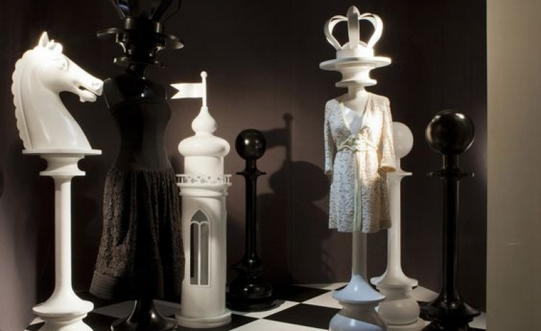 Moschino window display with theme inspired from the game of chess for its boutique in Milan.