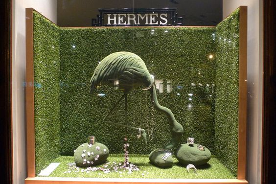 Nature and green spring as the main theme for this window display for Hermes, visual merchandising seen in Paris.